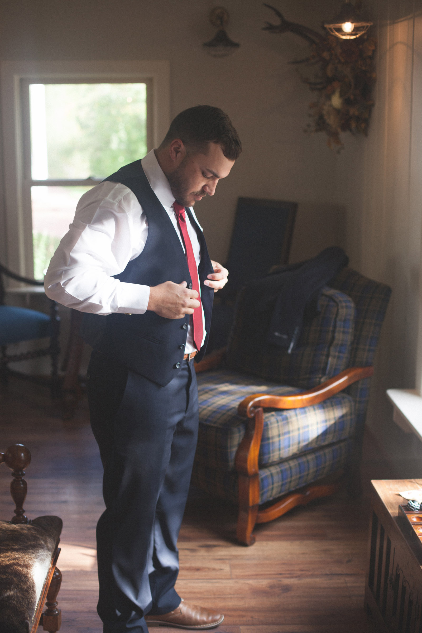 groom looking down before his elopement ceremony in durango co