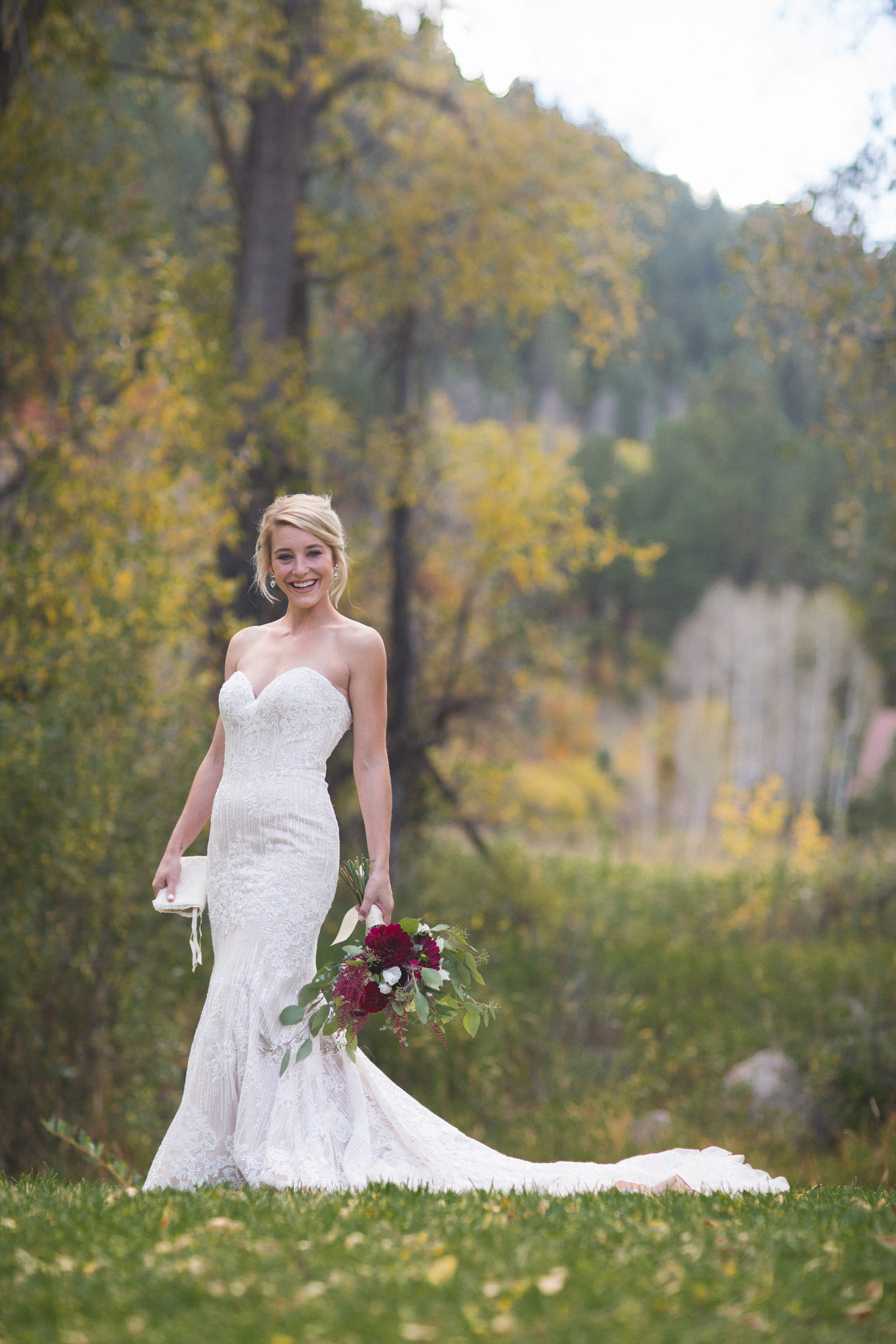 037-beautiful-portrait-of-bride-in-dress-in-nature-and-photojournalistic-photography-in-durango-colorado-elopement-wedding
