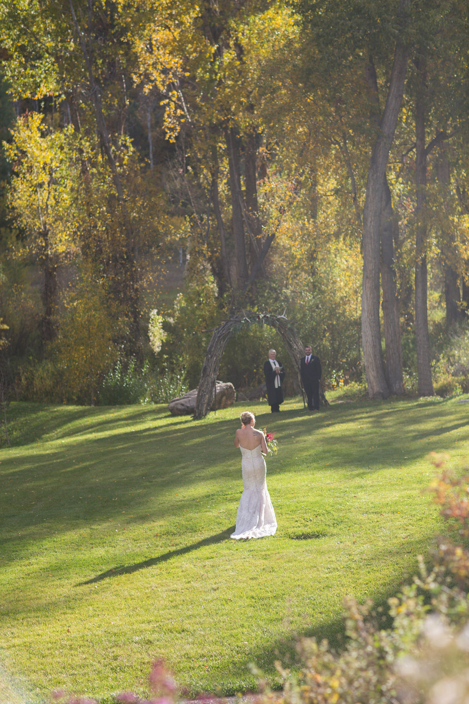 059-groom-smiling-at-bride-during-private-elopement-wedding-ceremony-in-durango-colorado