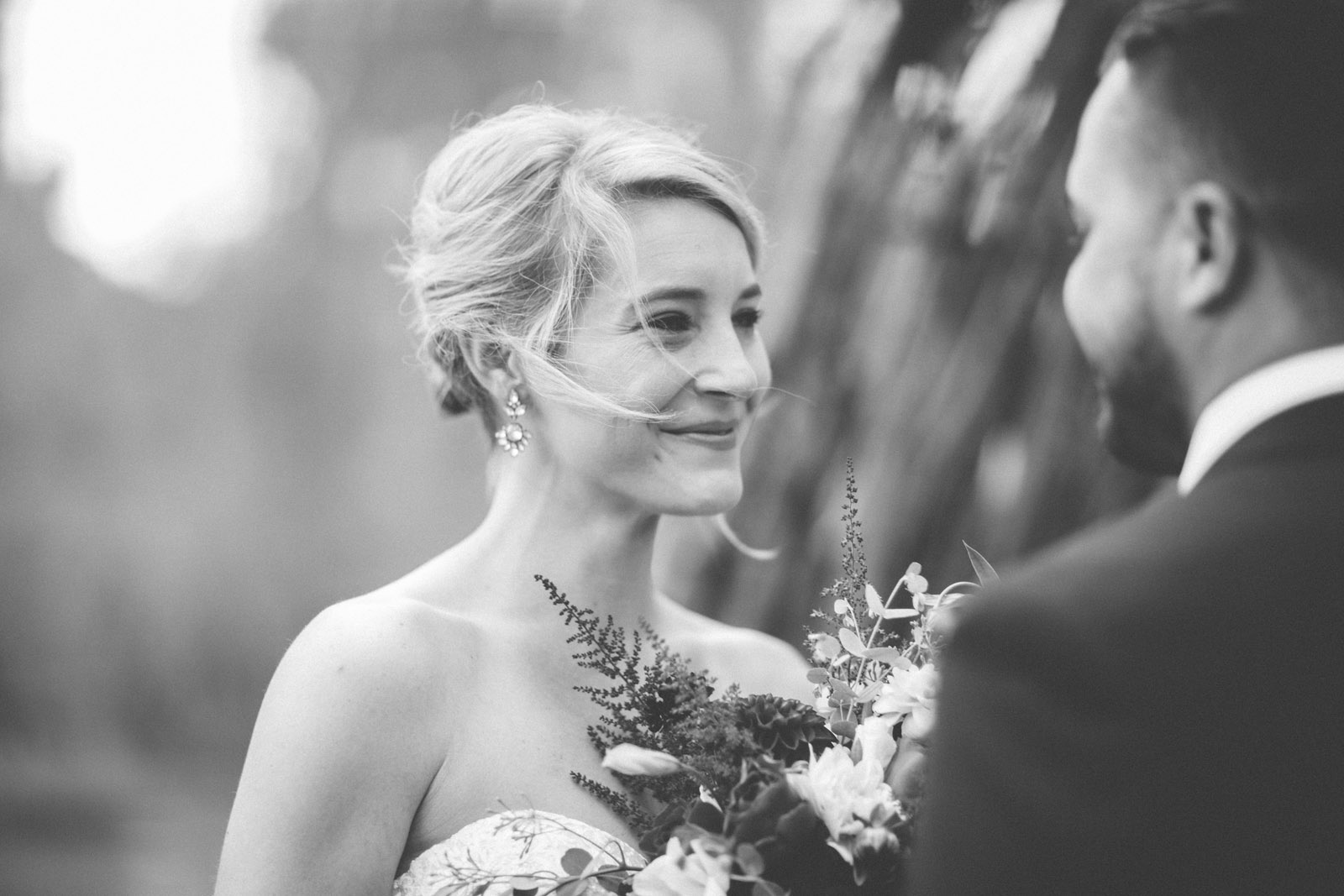 bride smiling at groom during private elopement wedding ceremony at durango co