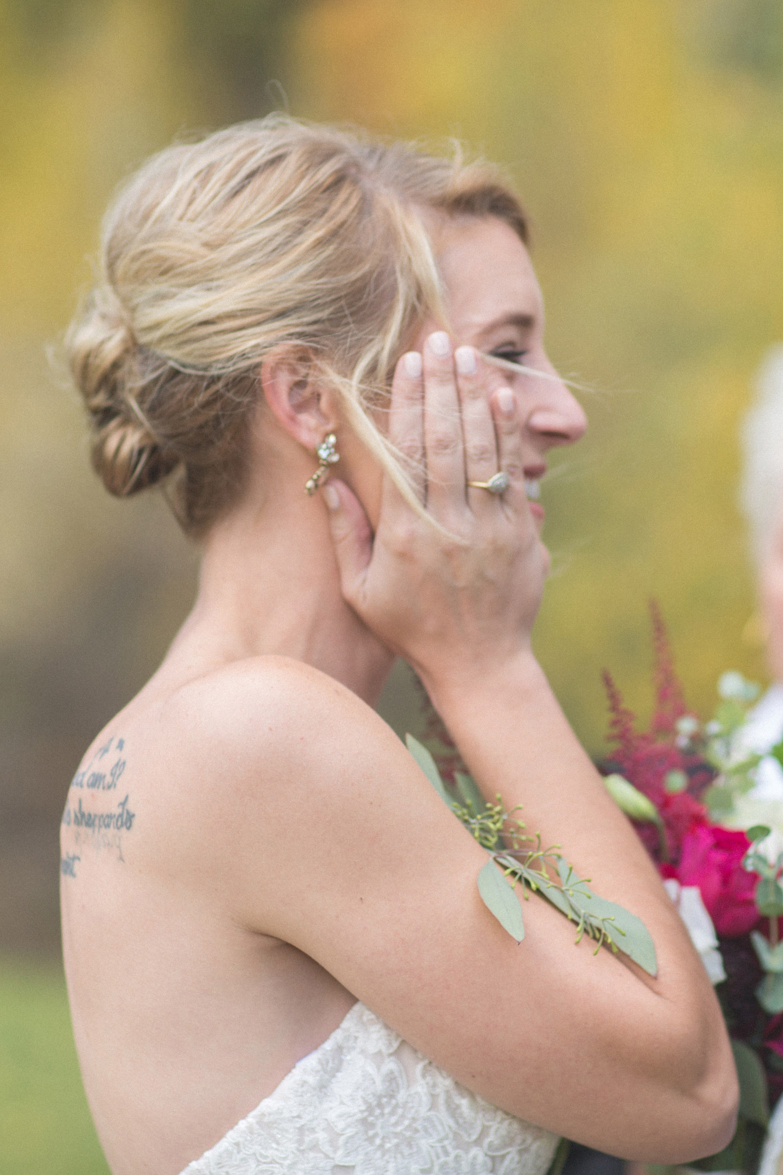 bride smiling at groom during private elopement wedding ceremony in durango co forest