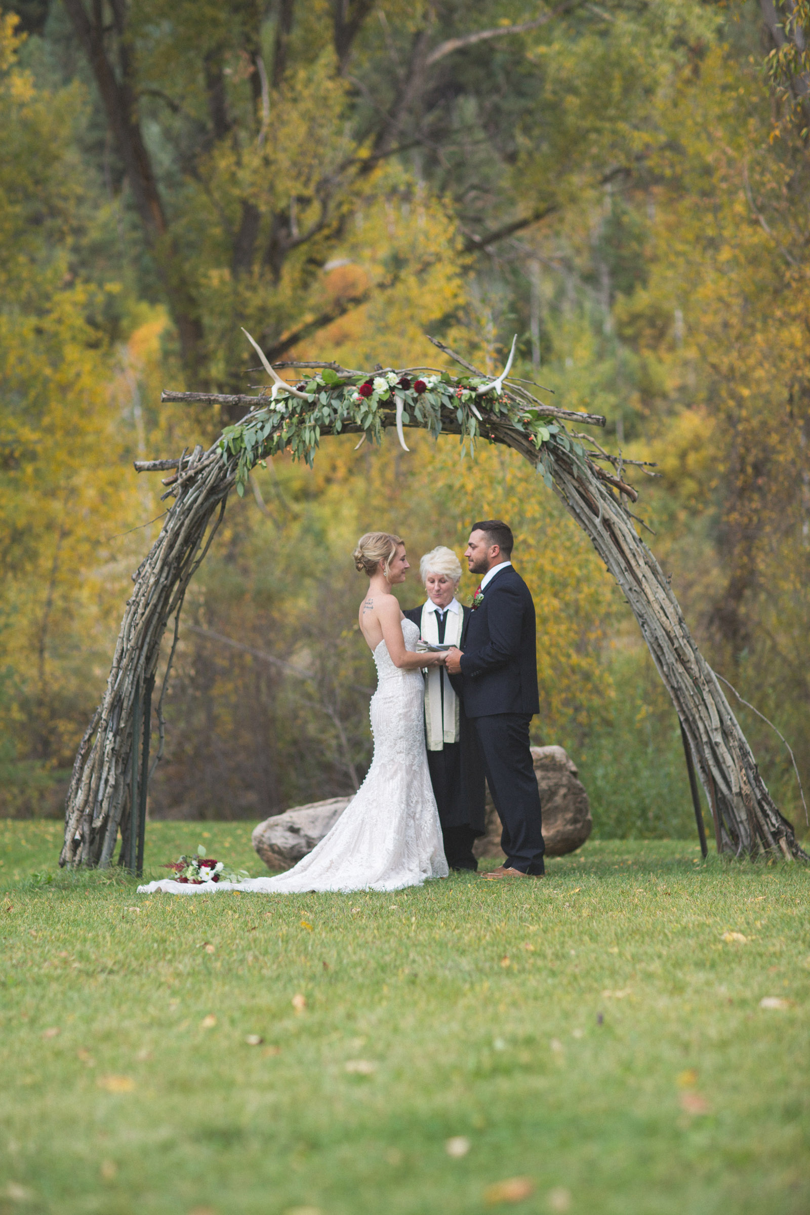 069-bride-and-groom-during-private-elopement-wedding-ceremony-in-durango-co-forest