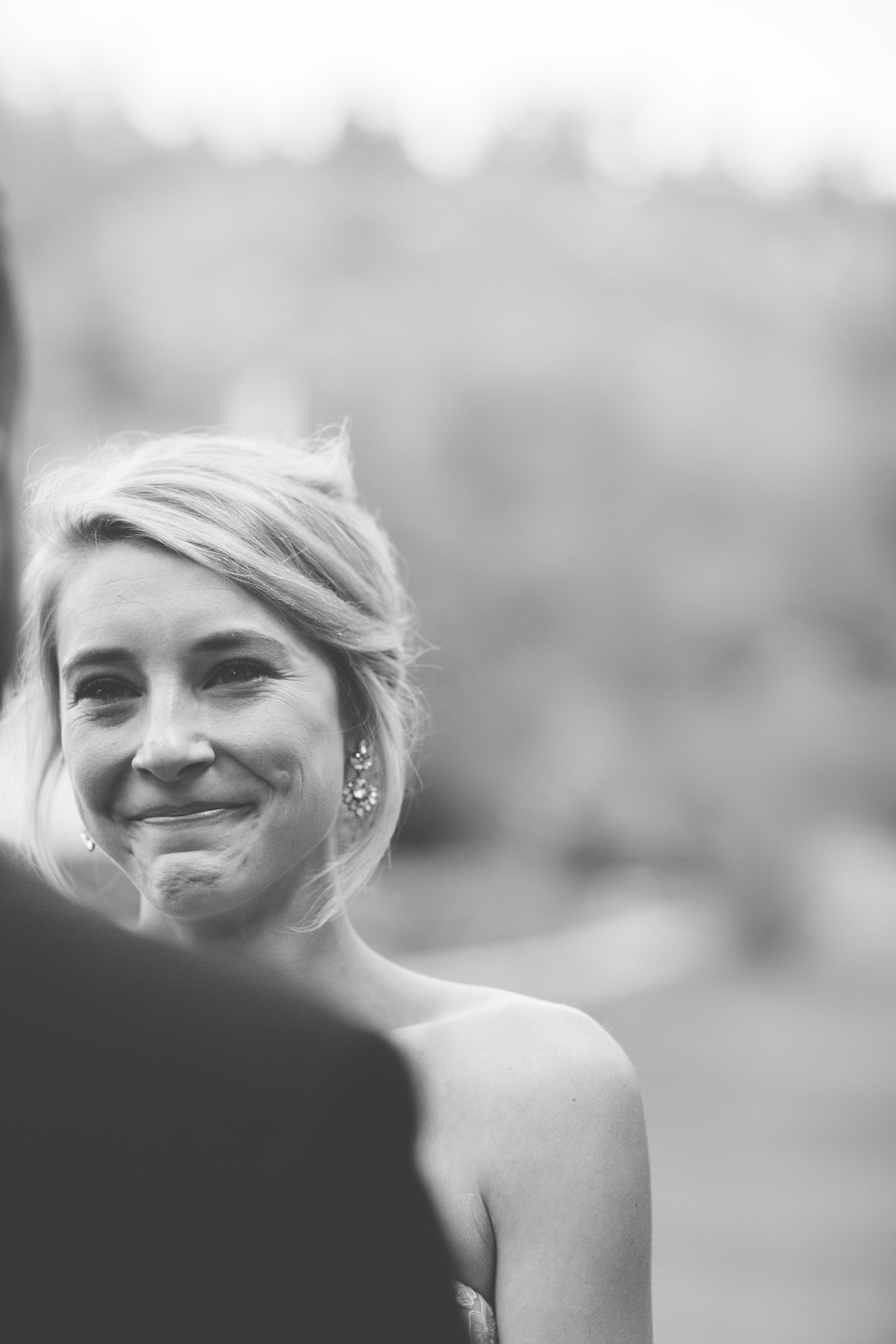 074-bride-smiling-at-groom-during-private-elopement-wedding-ceremony-at-durango-co