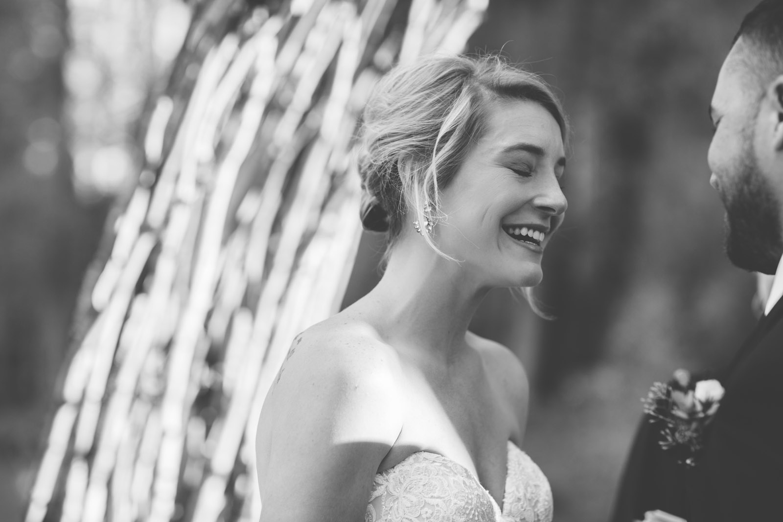 089-bride-and-groom-laughing-during-private-elopement-wedding-ceremony-in-durango-co-forest