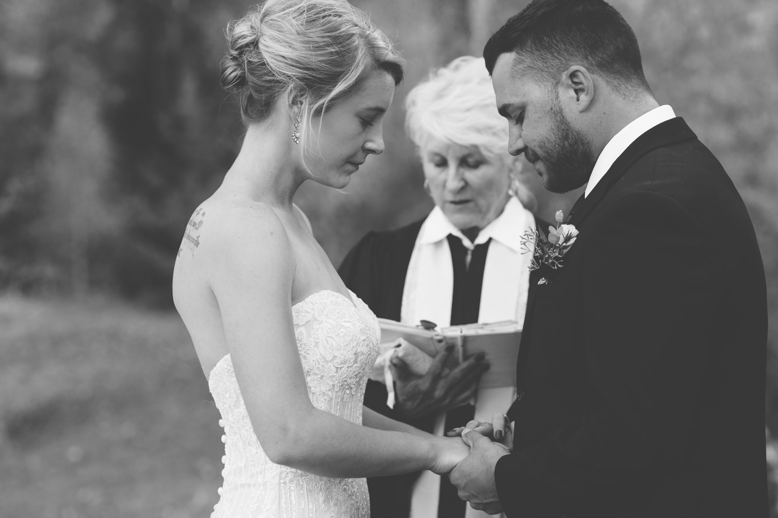 094-bride-and-groom-praying-during-private-elopement-wedding-ceremony-in-durango-co-forest