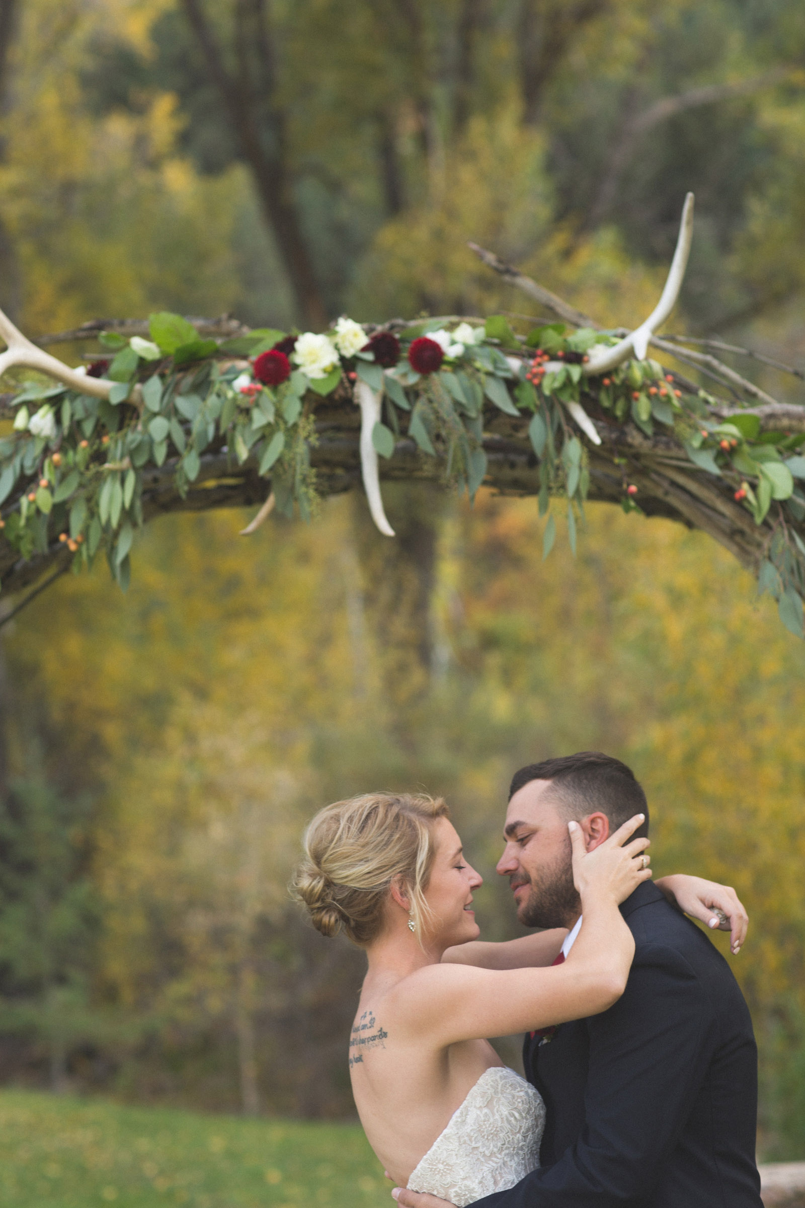 099-bride-and-groom-first-kiss-during-private-elopement-wedding-ceremony-in-durango-co-forest