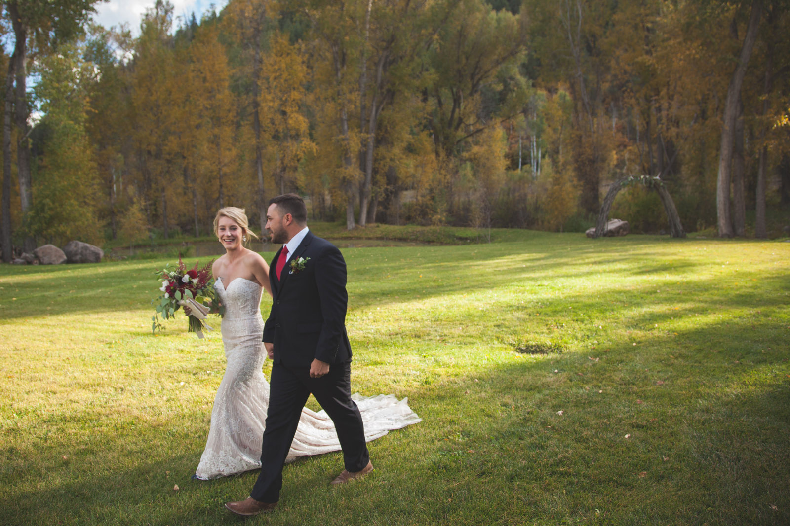 102-bride-and-groom-first-kiss-during-private-elopement-wedding-ceremony-in-durango-co-forest