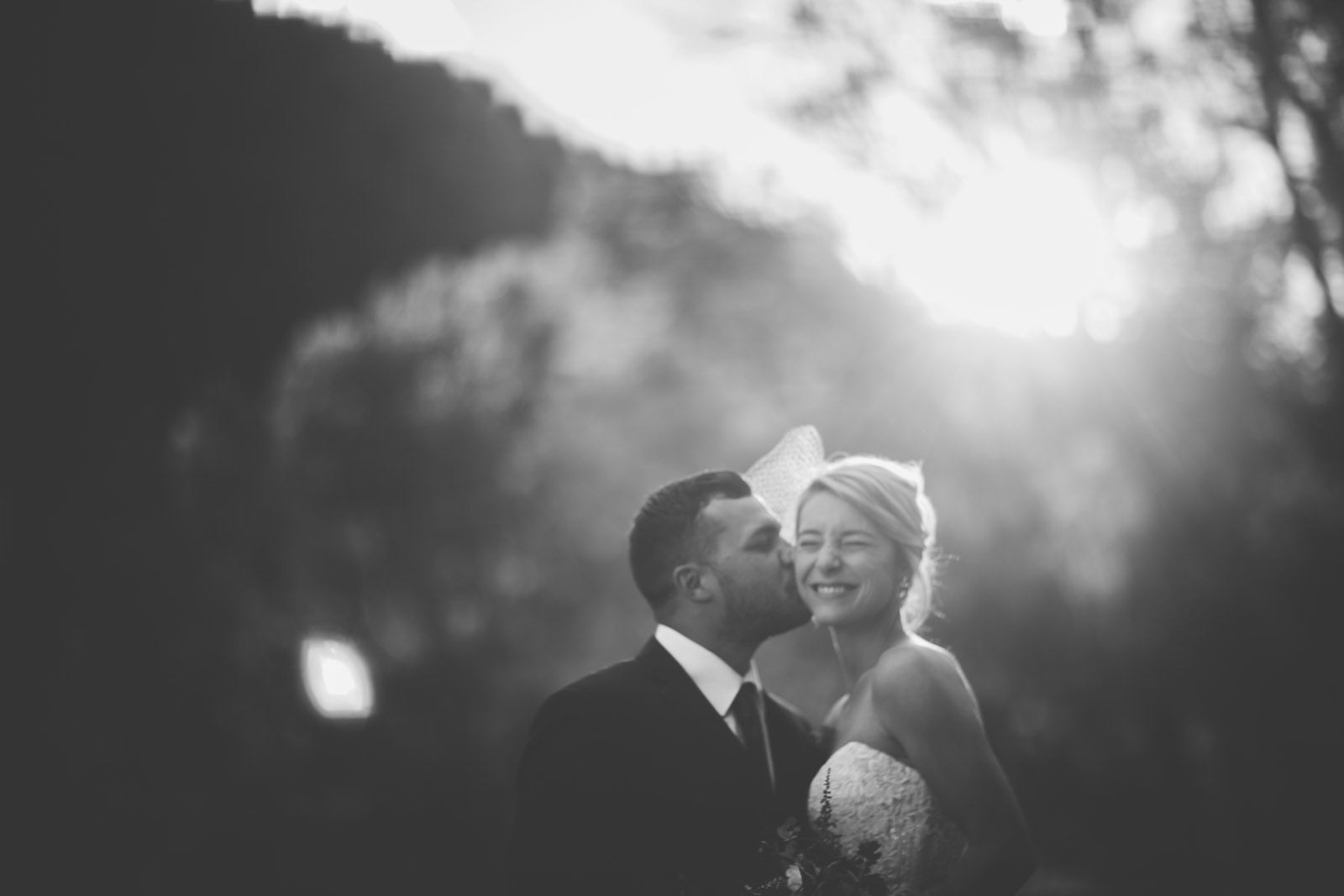 beautiful bride and groom kissing during ggolen hour at elopement wedding in durango co