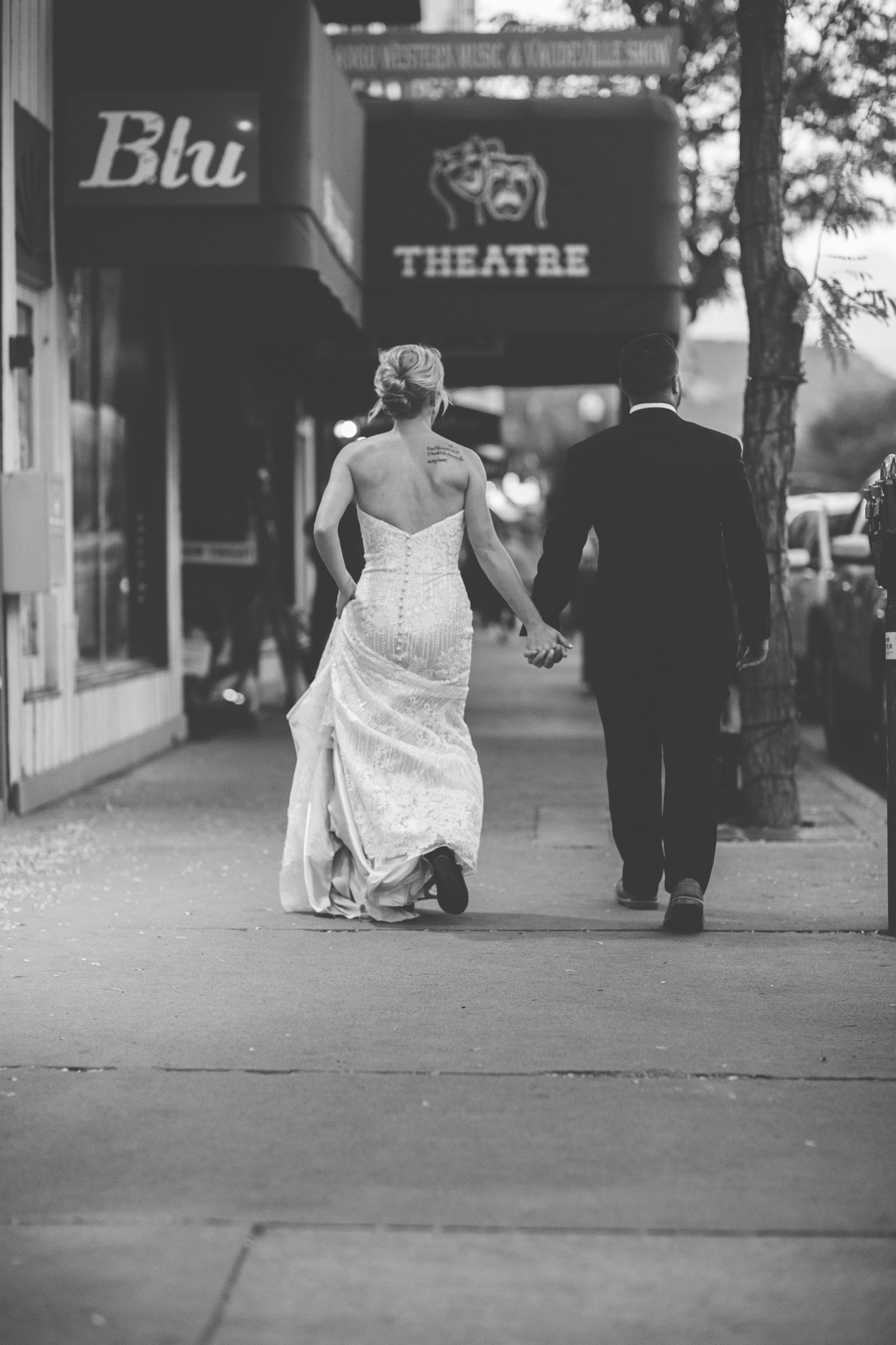 181-beautiful-bride-and-groom-photojournalist-portraits-at-elopement-wedding-in-durango-colorado-downtown